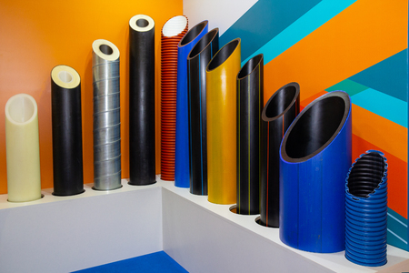 Plastic water pipes in a display at the exhibition. Industry