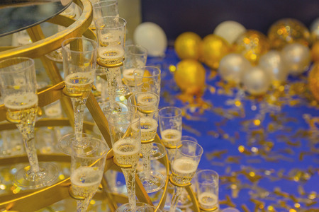 Pyramid from glasses of champagne yellow color. Wedding ceremony