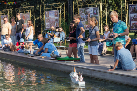 Makeevka, Ukraine - August 25, 2018: Children take part in competitions in ship-modeling sport in the citys fountain at the celebration of the City Day