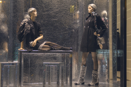 Female mannequins in a shop window. Store