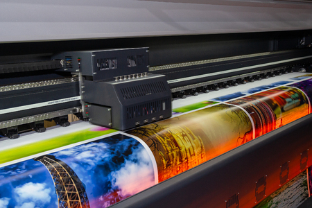 Large format printing machine in operation. Industry Foto de archivo