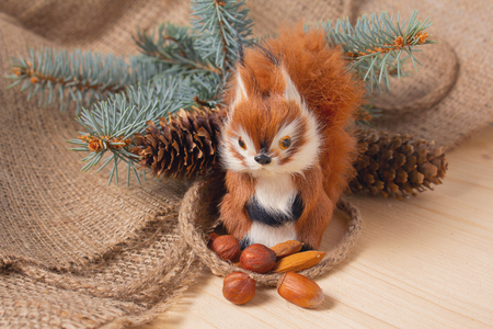 Toy squirrel under ther Christmas tree. Gift