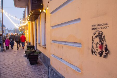 Kiev, Ukraine - December 30, 2018: Graffiti on the wall of Kiev street with a portrait of a murdered activist with the words Who ordered Ekaterina Gadzyuk in Ukrainian