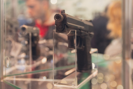 Guns on the counter of the store close-up. Weapons Stock Photo