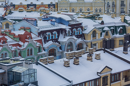 Color houses in the classic style covered with snow. Architecture