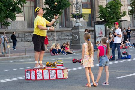 Kiev, Ukraine - June 19, 2016: Street artist juggles in front of passersby on Khreschatyk Street