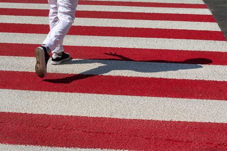 Red and white lanes and pedestrian legs