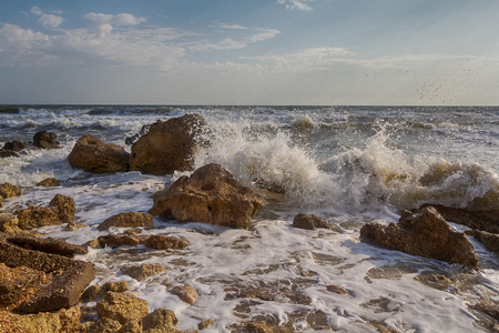 Waves stumble across rocks on the coast. Nature