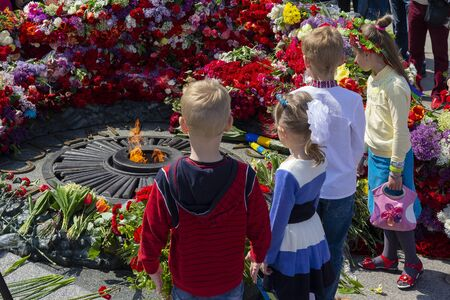 Kiev, Ukraine, - May 09, Kiev: Children at the eternal flame at the memorial of fallen soldiers of the Second World War