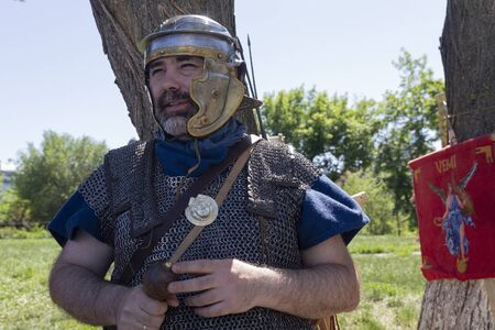 Kiev, Ukraine - May 27, 2018: Man in the armor of a Roman regioner at a festival of historical reconstruction