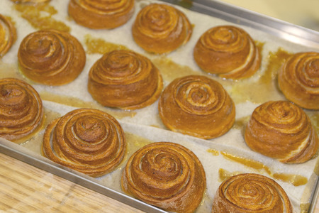 Tasty sweet pastries on on the baking sheet. Food