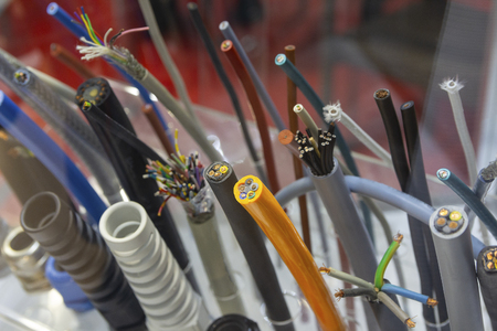 Different separation power cables on the showcase close up. Industry Stok Fotoğraf