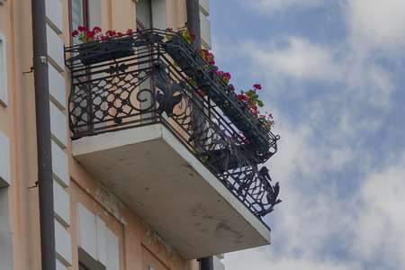 Flowers on the balcony of a luxury house in a classic style. Architecture