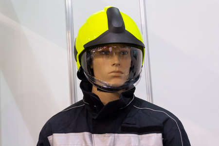 Maniken in the helmet and the form of a rescuer. Industry