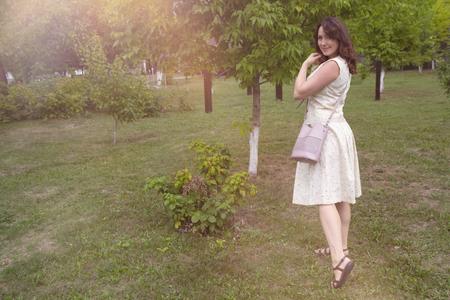 Beautiful woman in a green garden. People Stok Fotoğraf - 123963064