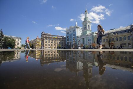 Kiev, Ukraine - August 09, 2017: Townspeople in the historic square of the city at noon after rain Editöryel