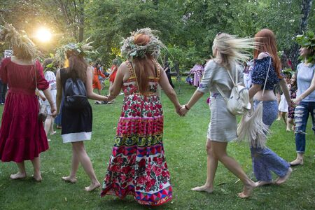 Kiev, Ukraine - July 06, 2017: Women drive a round dance during the celebration of a traditional Slavic holiday of Ivan Kupala