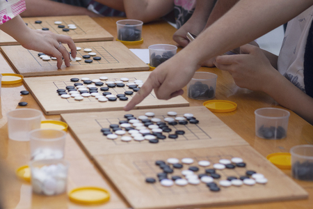 People participate in the go game.  Alphago Stok Fotoğraf - 123963090