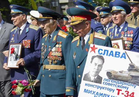 Kiev, Ukraine - May 09, 2016: World War II veterans marching to the tomb of the Unknown Soldier in Park of Eternal Glory
