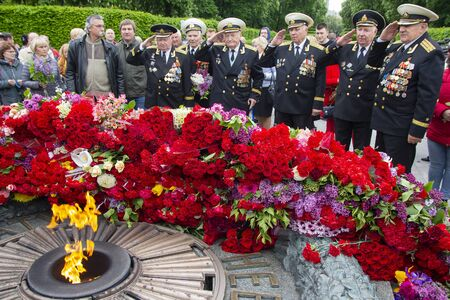 Kiev, Ukraine - May 09, 2019: Veterans of the Second World War cry flowers at the memorial in the Park of Eternal Glory Editöryel