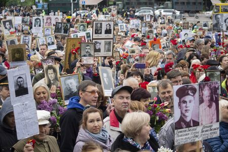 Kiev, Ukraine - May 09, 2019: Citizens with portraits of the ancestors who died - warriors on the march on the anniversary of the victory in World War II