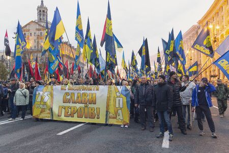 Kiev, Ukraine - October 14, 2017: Nationalist parties and movements during the march on the anniversary of the creation of the Ukrainian army. The inscription on the banner Do not disgrace the memory of the heroes of the UPA