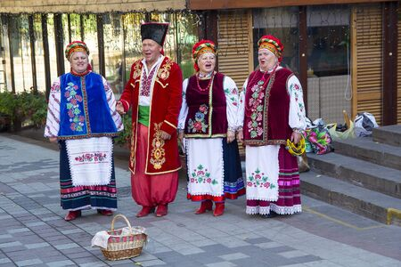 Kiev, Ukraine - October 14, 2018: Peoples ensemble in national costumes performs on city street