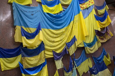 Kiev, Ukraine - May 18, 2019: Flags of military units participating in hostilities in the east of the country in a museum exposition