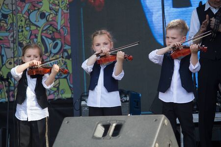 Kiev, Ukraine - May 19, 2019: Children playing violins on the stage of the Kleizmer music festival on Kontraktova Square Editöryel