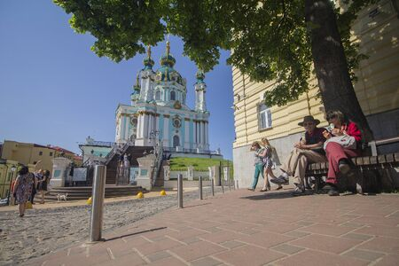 Kiev, Ukraine - May 19, 2019: Citizens and tourists near the St. Andrews Church Editöryel