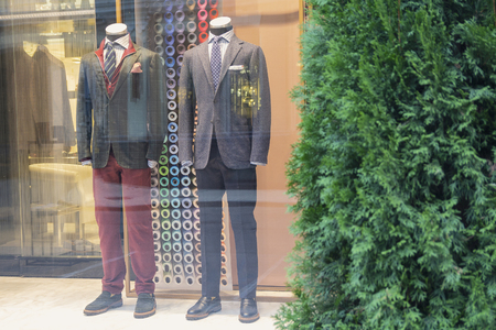 Mens mannequins in the window of a luxury store