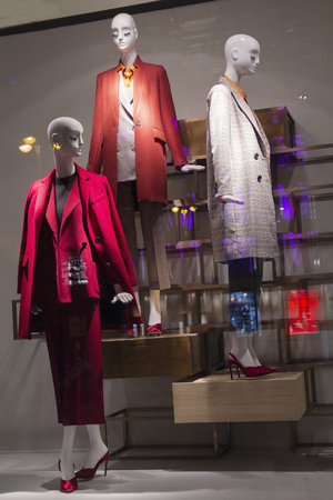 Female mannequin in a shop window. Fashion and sales