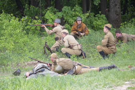 Kiev, Ukraine - on May 09, 2018: People in uniform of fighters of the Red Army of World War II conduct a battle at historical reconstruction on an anniversary of the victory