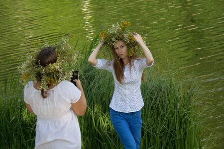 Kiev, Ukraine - July 06, 2017: Young girls in a wreath of flowers at the celebration of the traditional Slavic holiday of Ivan Kupala