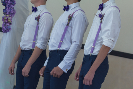 Men in white shirts and suspenders at a wedding ceremony. People Standard-Bild