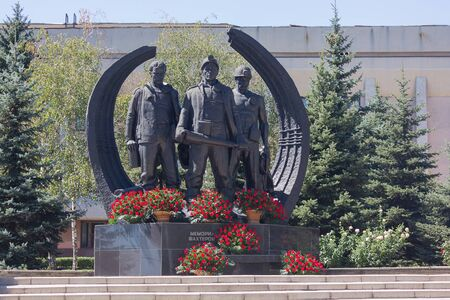 Makeevka, Ukraine - August 23, 2018: Flowers laid at the monument to the fallen miners Editöryel
