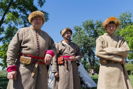 Kiev, Ukraine - May 27, 2018: Men in costumes of Cossacks at the festival of historical reconstruction Editöryel