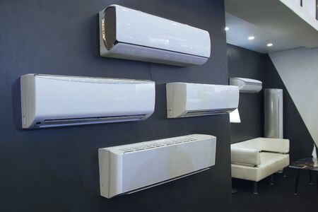 Air conditioner in a row for sale in a shop during summer hot season