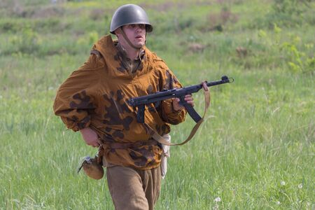 Kiev, Ukraine - May 09, 2018: Man in the form of an infantryman of the Red Army of World War II at the historical reconstruction on the anniversary of the victory