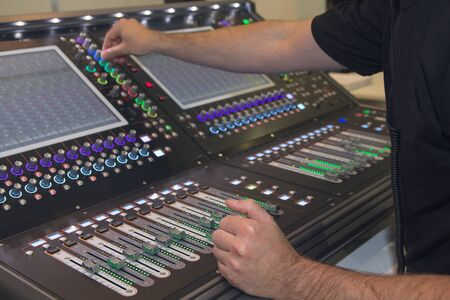 Man using mixing console in sound recording studio. Music Imagens