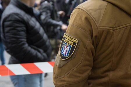 Kiev, Ukraine - May 09, 2019: Chevron of a municipal police officer at the police cordon