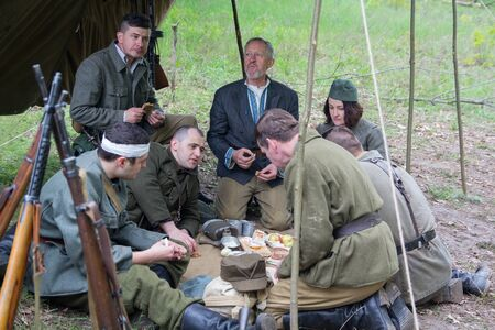 Kiev, Ukraine - May 09, 2019: People in the form of fighters of the Ukrainian insurgent army at a historical festival on the anniversary of the end of the Second World War