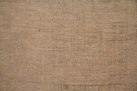 Natural linen coarse fabric. Backgrounds and Textures