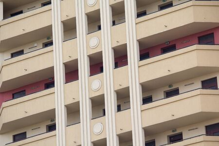 Facade of a beautiful modern building with balconies. Architecture