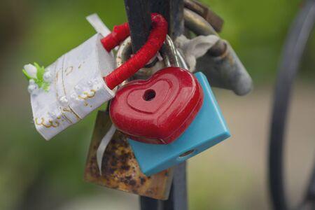 Locks on the railing of the bridge symbolizing love and loyalty Stok Fotoğraf