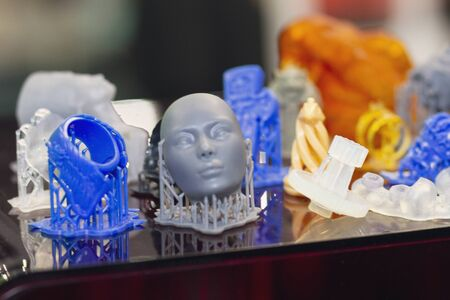 Variety of plastic products manufactured by 3D printing. Technologies