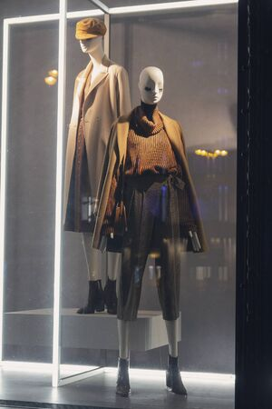 Female mannequins in trendy clothes in the shop window
