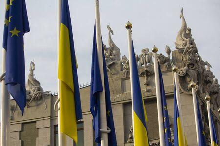 Flags of Ukraine and the European Union on flagpoles near the office of the President of Ukraine. Kiev