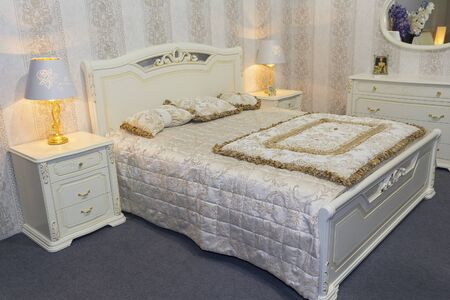 Luxury bedroom furniture in a classic style. Interier