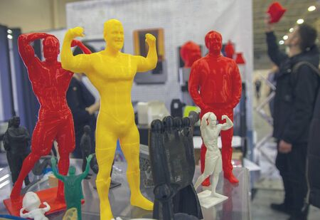 Production of 3D-printer prints on a table at an exhibition of modern technology